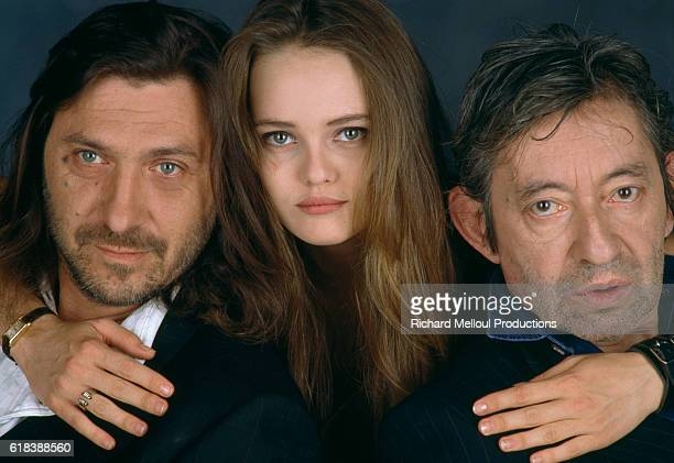 French actress and singer Vanessa Paradis holds onto French composer Franck Langolff and French actor and composer Serge Gainsbourg