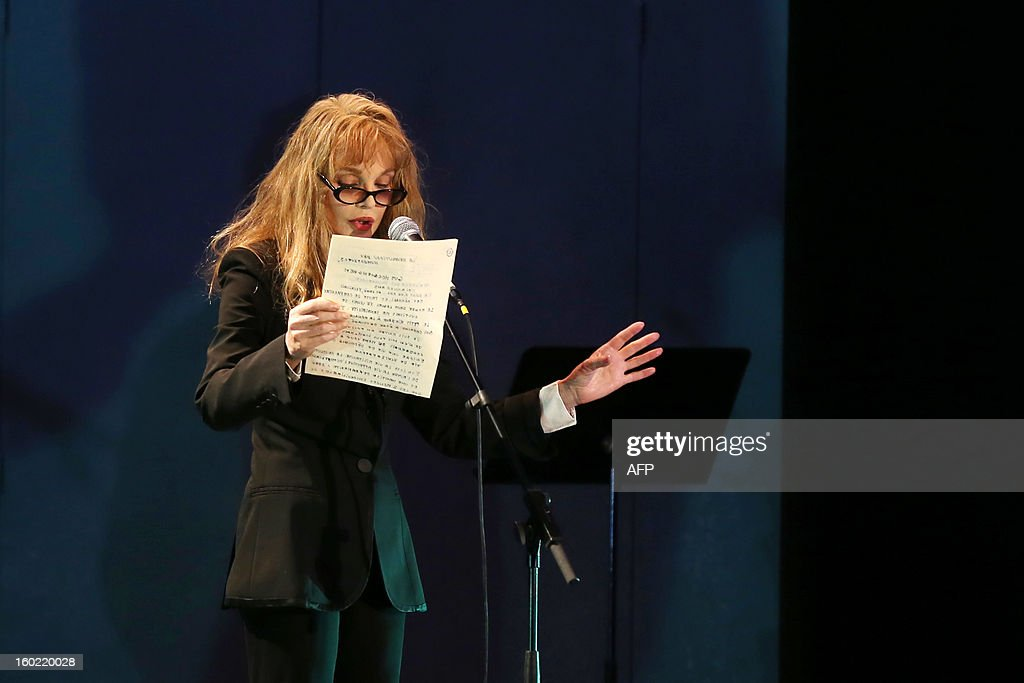 French actress Arielle Dombasle speaks during a special event gathering artists and celebrities in support of French government plans to legalise gay marriage and same-sex adoption on January 27, 2013 in Paris, two days before parliament takes up the text, which has been met with strong opposition from the right and the Catholic Church.