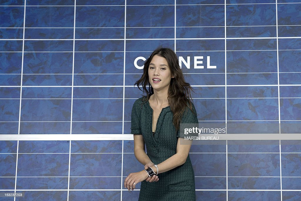 French actress Astrid Berges-Frisbey poses during a photocall prior to the Chanel Spring/Summer 2013 ready-to-wear collection show on October 2, 2012 at the Grand Palais in Paris.