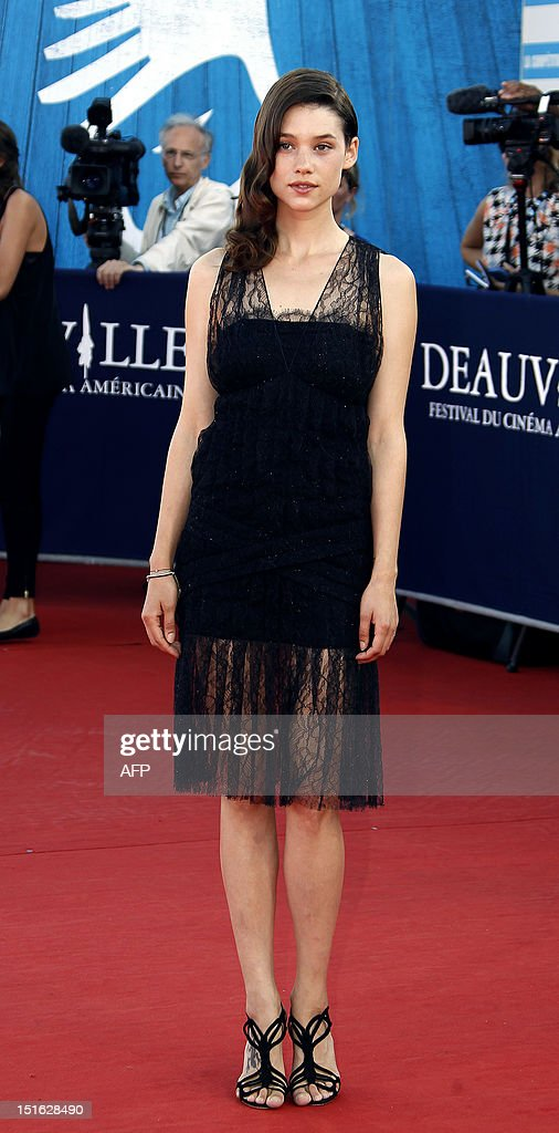 French actress Astrid Bergès-Frisbey poses on the red carpet as she arrives to attend the awarding ceremony off the 38th Deauville's US Film Festival on September 8, 2012 in the French northwestern sea resort of Deauville.