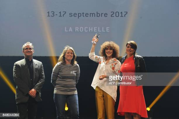 French actress Blandine Bellavoir and team members of the TV film 'Les petits meurtres d'Agatha Christies' celebrate after receiving the best serie...