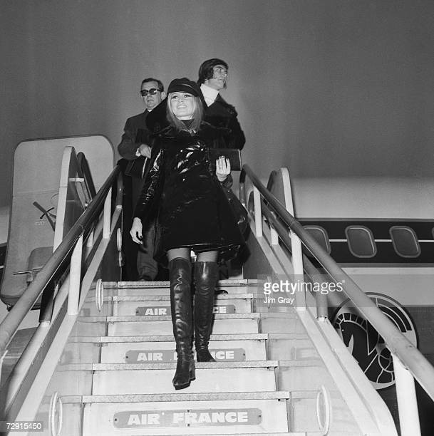 French actress Brigitte Bardot arrives at London Airport followed by her boyfriend Patrick Gilles 11th December 1968 She has flown in from Paris to...