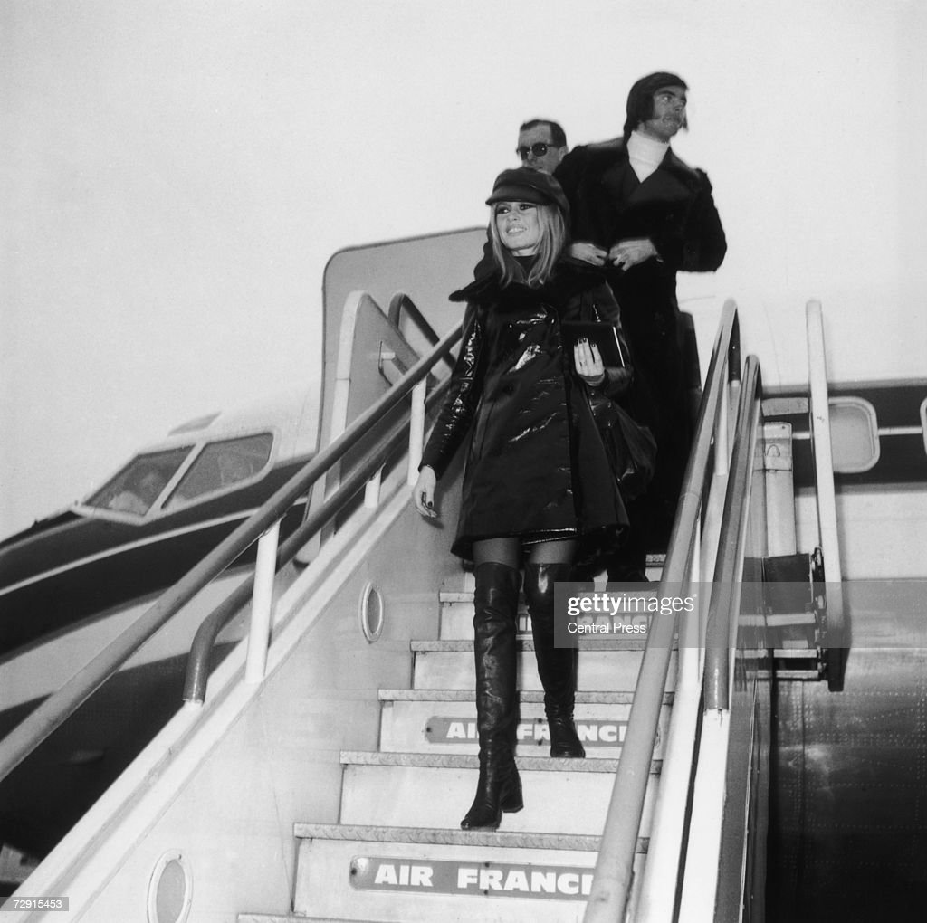 French actress <a gi-track='captionPersonalityLinkClicked' href=/galleries/search?phrase=Brigitte+Bardot&family=editorial&specificpeople=202903 ng-click='$event.stopPropagation()'>Brigitte Bardot</a> arrives at London Airport (now Heathrow) followed by her boyfriend Patrick Gilles, 11th December 1968. She has flown in from Paris to attend the premiere of her latest film 'Shalako', directed by Edward Dmytryk.