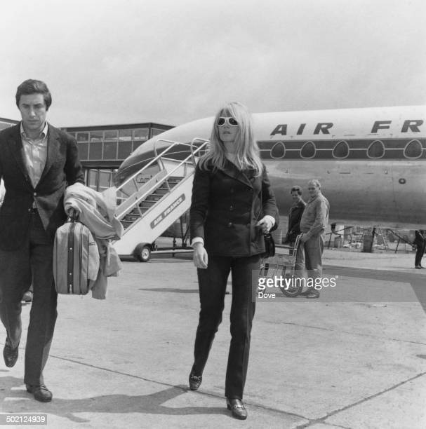 French actress Brigitte Bardot arriving with her boyfriend Bob Zaguri at Heathrow Airport London 9th May 1966