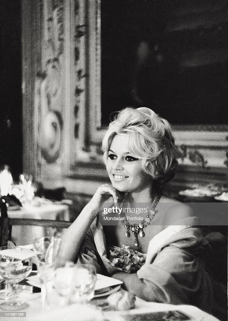 French actress <a gi-track='captionPersonalityLinkClicked' href=/galleries/search?phrase=Brigitte+Bardot&family=editorial&specificpeople=202903 ng-click='$event.stopPropagation()'>Brigitte Bardot</a> attending a party organized during the XIX International Film Festival by the film producer Raoul Levy at the Palazzo Barbaro. Venice, September 1958