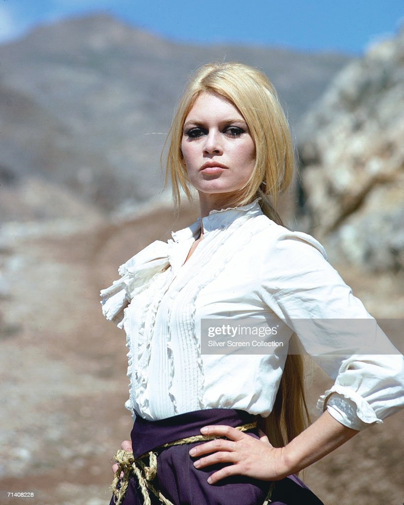 French actress <a gi-track='captionPersonalityLinkClicked' href=/galleries/search?phrase=Brigitte+Bardot&family=editorial&specificpeople=202903 ng-click='$event.stopPropagation()'>Brigitte Bardot</a> stands with her hands on her hips in a defiant pose during the filming of the western 'Shalako', circa 1968.