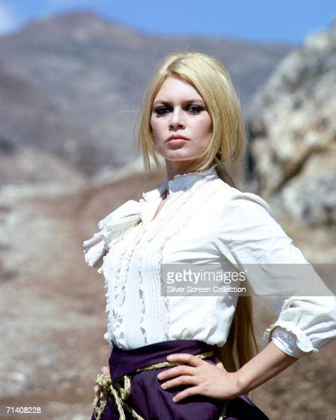 French actress Brigitte Bardot stands with her hands on her hips in a defiant pose during the filming of the western 'Shalako' circa 1968