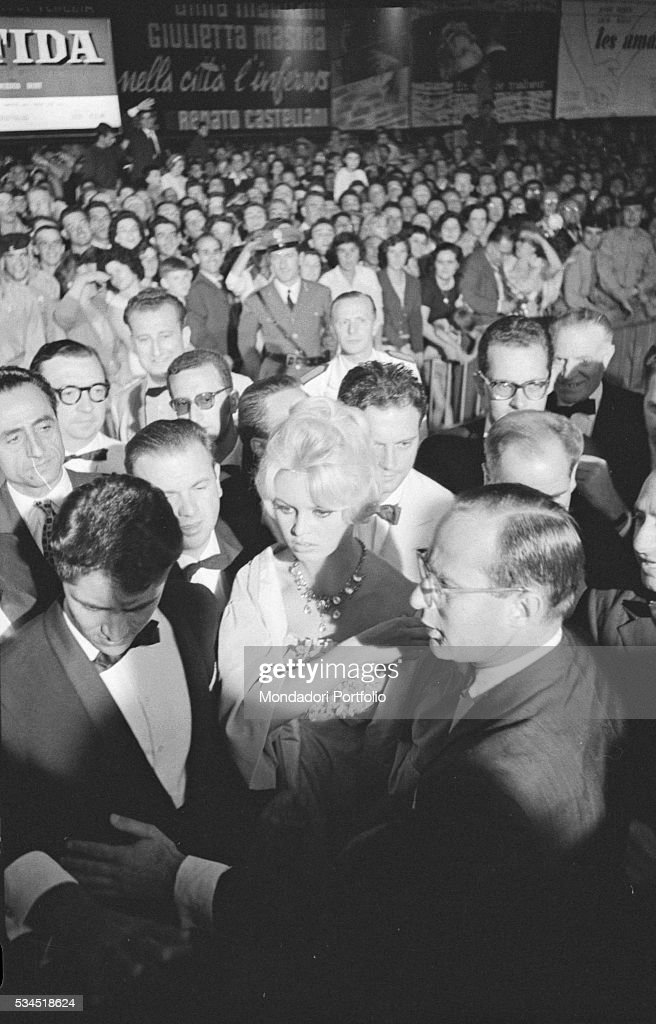 French actress Brigitte Bardot surrounded by the crowd at the 19th Venice International Film Festival. Venice, August 1958