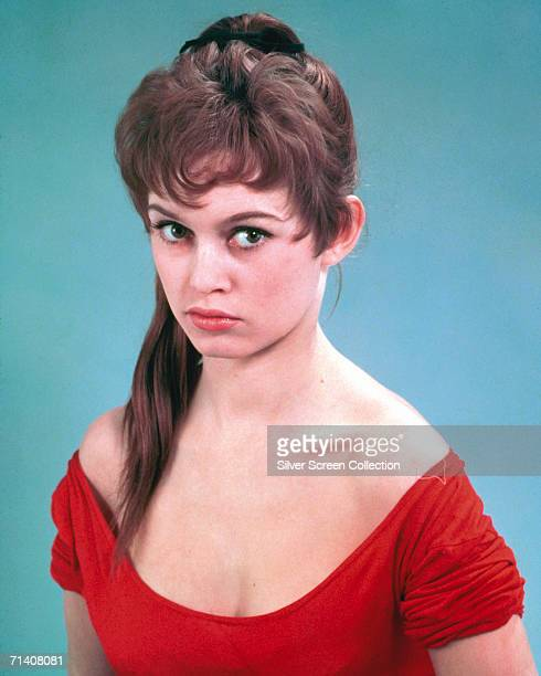 French actress Brigitte Bardot wearing a lownecked red dress circa 1955
