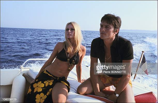 French actress Brigitte Bardot with French actor Alain Delon in 1968 in SaintTropez France