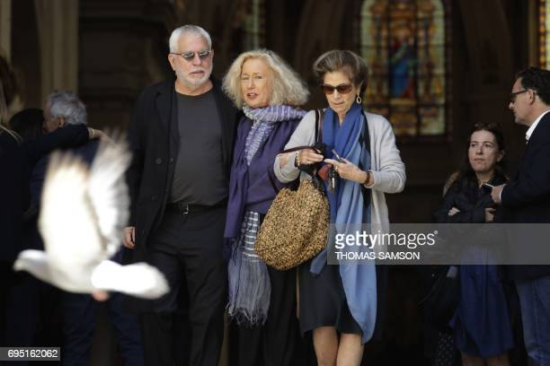 French actress Brigitte Fossey leaves the SaintRoch Church in Paris with other mourners after attending the funeral of French actor JeanMarc Thibault...