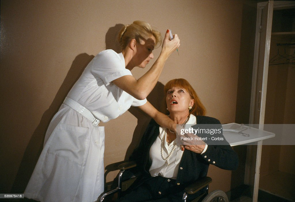 French actress Brigitte Lahaie attempts to stab Stephane Audran with a hypodermic needle in a scene from the 1988 French horror film, 'Faceless', directed by Jesus Franco. Telly Savalas and Helmut Berger also starred in the film.