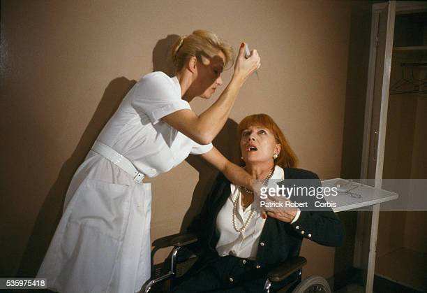 French actress Brigitte Lahaie attempts to stab Stephane Audran with a hypodermic needle in a scene from the 1988 French horror film 'Faceless'...