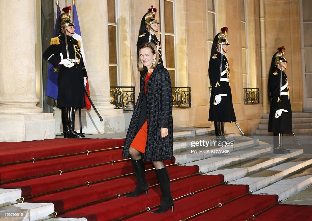 French actress Carole Bouquet arrives at the Elysee palace in Paris, before a state dinner as part of a two-day state visit of Italian President Giorgio Napolitano, on November 21, 2012.