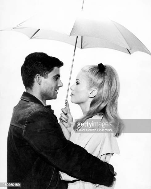 French actress Catherine Deneuve and Italian actor Nino Castelnuovo in a promotional portrait for 'The Umbrellas Of Cherbourg' directed by Jacques...