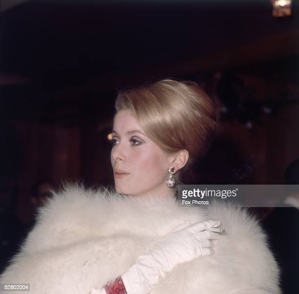 French actress Catherine Deneuve arriving at a Royal Film Performance of James H Hill's movie 'Born Free' at the Odeon Leicester Square London 14th...