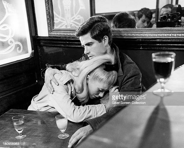 French actress Catherine Deneuve as Genevieve Emery and Italian actor Nino Castelnuovo as Guy Foucher in a production still from 'The Umbrellas Of...
