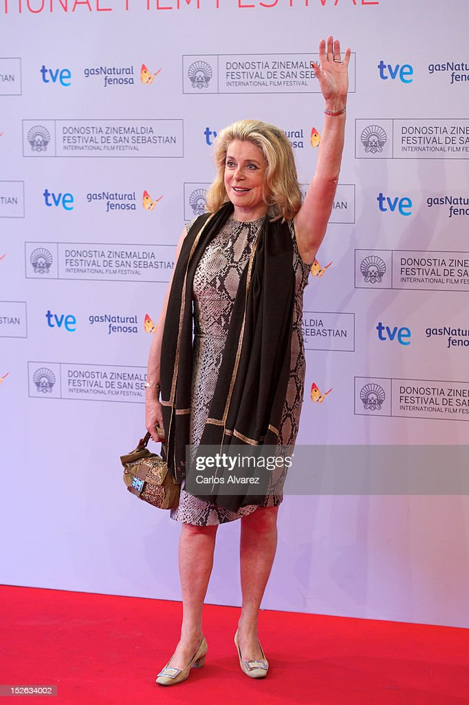 French actress <a gi-track='captionPersonalityLinkClicked' href=/galleries/search?phrase=Catherine+Deneuve&family=editorial&specificpeople=123833 ng-click='$event.stopPropagation()'>Catherine Deneuve</a> attends the 'As Linhas De Torres' photocall at the Kursaal Palace during the 60th San Sebastian International Film Festival on September 23, 2012 in San Sebastian, Spain.