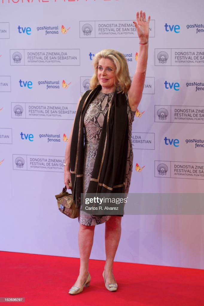 French actress <a gi-track='captionPersonalityLinkClicked' href=/galleries/search?phrase=Catherine+Deneuve&family=editorial&specificpeople=123833 ng-click='$event.stopPropagation()'>Catherine Deneuve</a> attends the 'As Linhas De Torres photocall photocall at the Kursaal Palace during the 60th San Sebastian International Film Festival on September 23, 2012 in San Sebastian, Spain.