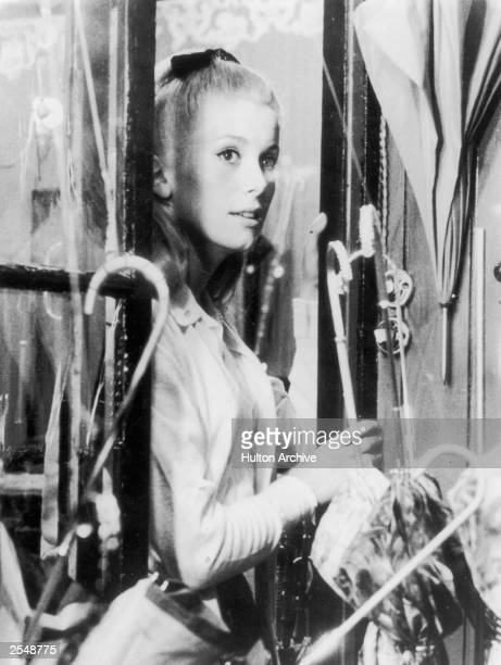 French actress Catherine Deneuve in a still from Jacques Demy's film 'Parapluies de Cherbourg' also known as 'Umbrellas of Cherbourg' 15th May 1964
