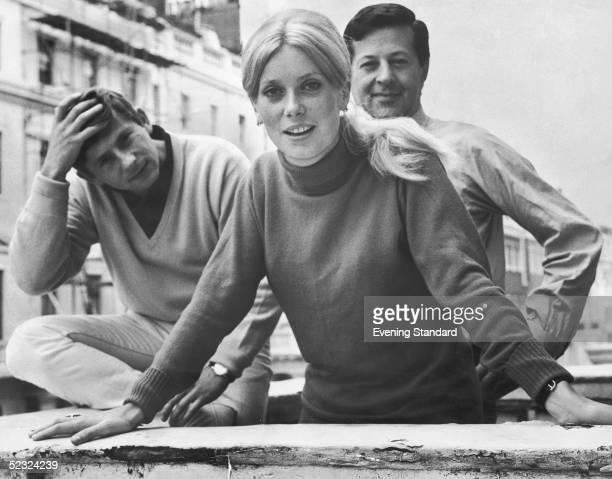 French actress Catherine Deneuve in London with Polish director Roman Polanski and producer Eugene Gutowski 17th August 1964 Deneuve is due to start...