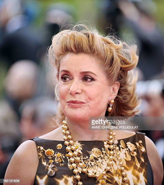 French actress Catherine Deneuve poses as she arrives to attend the Closing Ceremony of the 61st Cannes International Film Festival on May 25 2008 in...