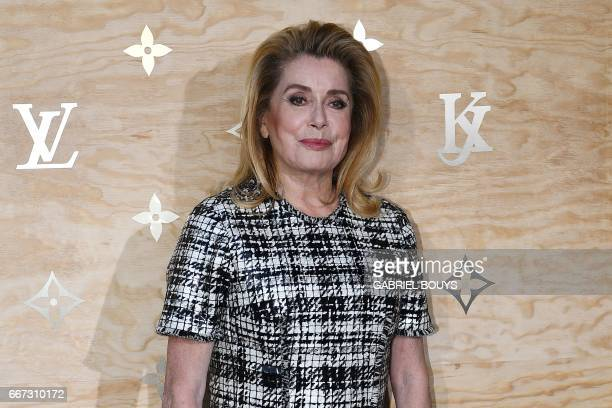 French actress Catherine Deneuve poses during a photocall ahead of a diner for the launch of a Louis Vuitton leather goods collection in...