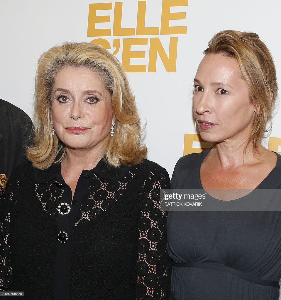 French actress Catherine Deneuve (L) poses flanked by director Emmanuelle Bercot prior to attend the Premiere of their new movie 'Elle s'en va' ('On my way'), on September 16, 2013 in Paris.