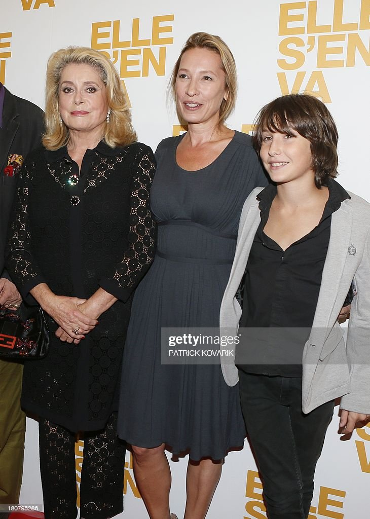 French actress Catherine Deneuve poses flanked by director Emmanuelle Bercot and actor Nemo Schiffman prior to attend the Premiere of their new movie 'Elle s'en va' ('On my way'), on September 16, 2013 in Paris.