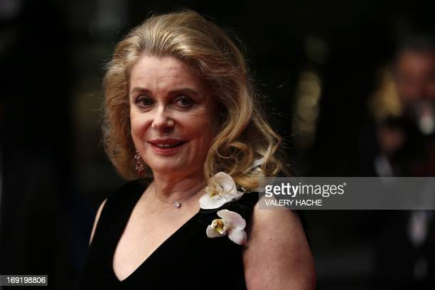 French actress Catherine Deneuve poses on May 21 2013 as she arrives for the screening of the film 'La Grande Bellezza' presented in Competition at...