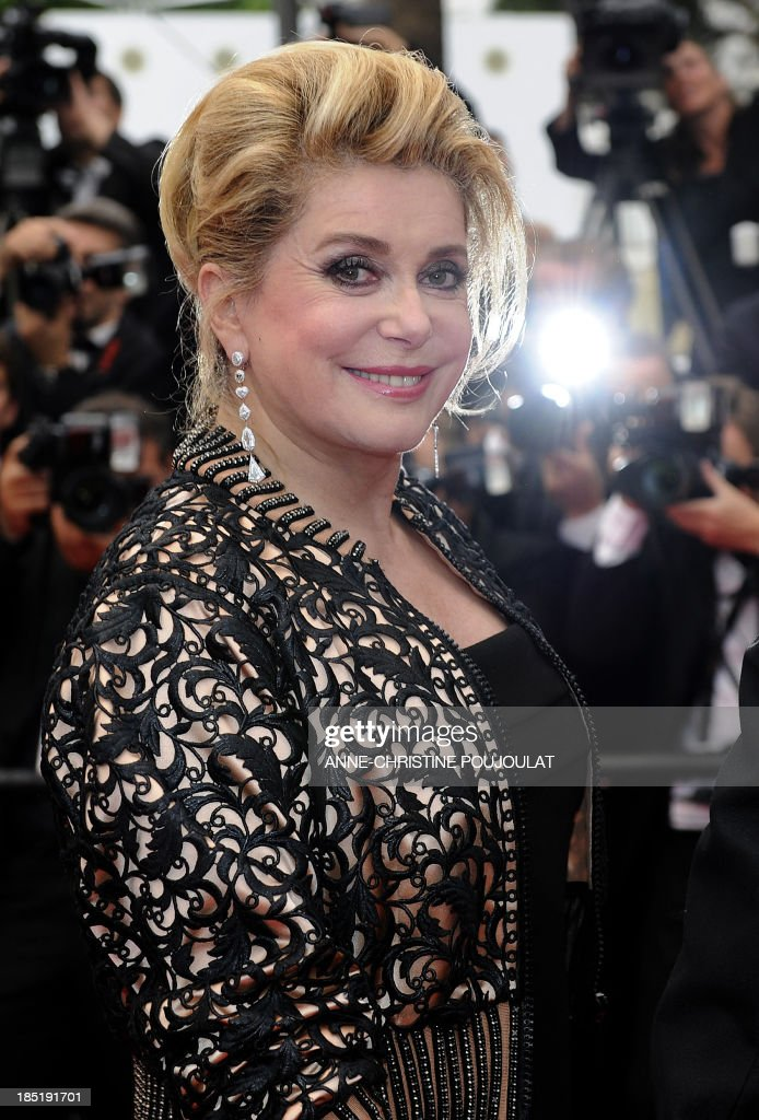 French actress Catherine Deneuve poses on the red carpet before the closing ceremony of the 64th Cannes Film Festival on May 22, 2011 in Cannes.