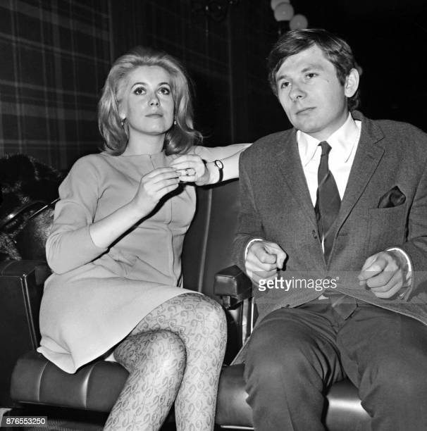 French actress Catherine Deneuve poses with Polish director Roman Polanski during a screening of the film Repulsion on January 7 1966 at a cinema on...