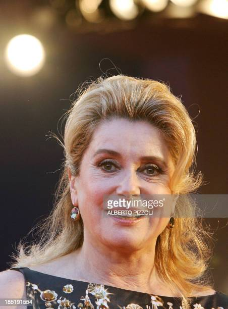 French actress Catherine Deneuve president of the jury arrives at the 63rd Venice International Film Festival's gala opening 30 August 2006 at the...