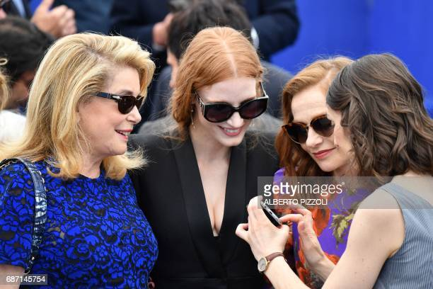 French actress Catherine Deneuve US actress and member of the Feature Film jury Jessica Chastain and French actress Isabelle Huppert attend on May 23...