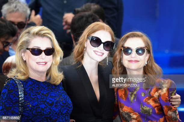 French actress Catherine Deneuve US actress and member of the Feature Film jury Jessica Chastain and French actress Isabelle Huppert pose on May 23...
