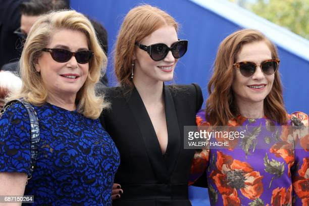 French actress Catherine Deneuve US actress Jessica Chastain and French actress Isabelle Huppert pose on May 23 2017 during a photocall for the '70th...