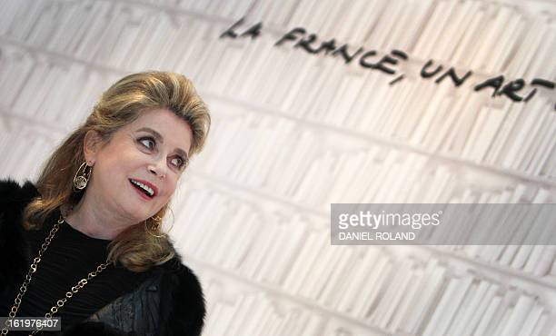 French actress Catherine Deneuve visits the consumer good trade fair 'Ambiente' in Frankfurt am Main on February 18 2013 This years partner country...
