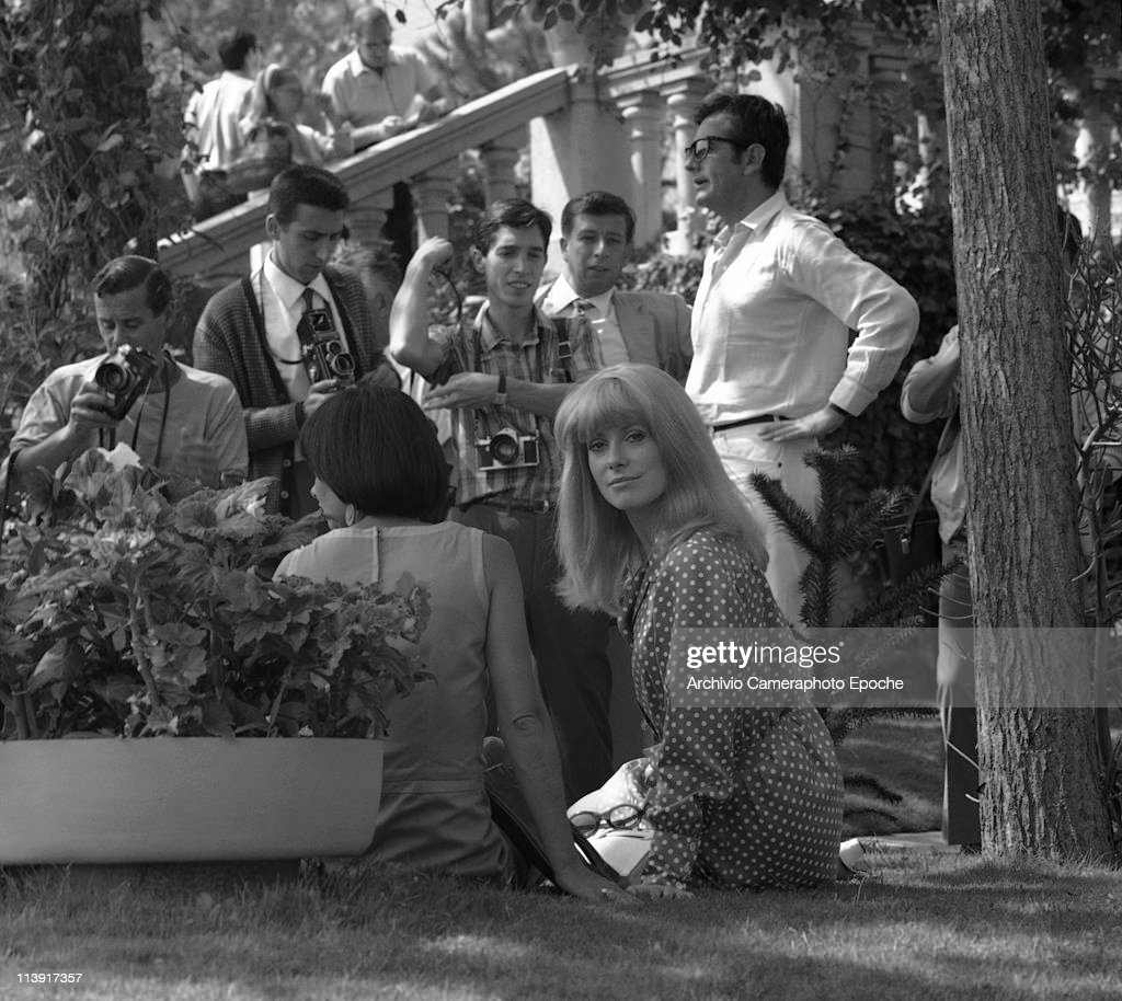 French actress Catherine Deneuve wearing a polkadotted dress posing for photographers outside the Excelsior Hotel at Lido Venice 1966