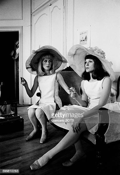 French actress Catherine Deneuve with her actress sister Françoise Dorléac on the set of the musical film 'The Young Girls of Rochefort' directed by...