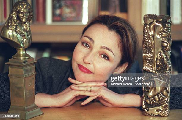 French actress Catherine Frot poses at home in Paris with her Cesar and Moliere awards