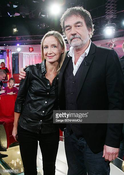 French actress Catherine Marchal and husband actor and director Olivier Marchal attend 'Vivement Dimanche' TV show on October 30 2012 in Paris France