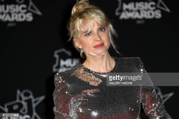 French actress Cecile Cassel poses upon her arrival to attend the 19th NRJ Music Awards at the Palais des Festivals in Cannes southeastern France on...