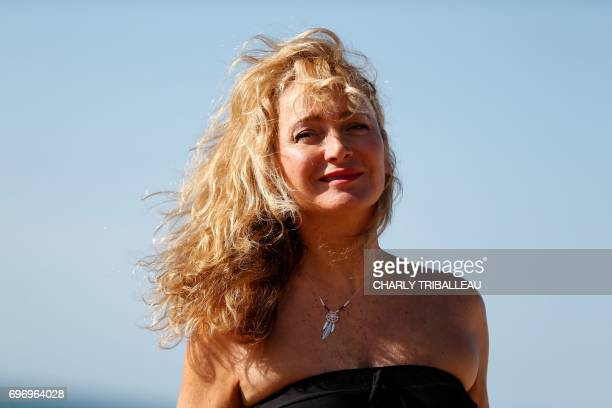 French actress comedian dancer writer and theater director Julie Ferrier poses during a photocall for the Cabourg Romantic Film Festival in Cabourg...