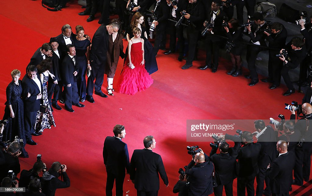 French actress Delphine Chuillot, Spanish actor Sergi Lopez, French actress Amira Casar, German actor David Kross, French actor Denis Lavant, Swiss actor David Bennent, Danish actor Mads Mikkelsen and his wife Hanne Jakobsen, French director Arnaud des Pallieres and his partner, French actress Melusine Mayance and French-Austrian actress Roxane Duran pose on May 24, 2013 as they arrive for the screening of the film 'Michael Kohlhaas' presented in Competition at the 66th edition of the Cannes Film Festival in Cannes. Cannes, one of the world's top film festivals, opened on May 15 and will climax on May 26 with awards selected by a jury headed this year by Hollywood legend Steven Spielberg. AFP PHOTO / LOIC VENANCE
