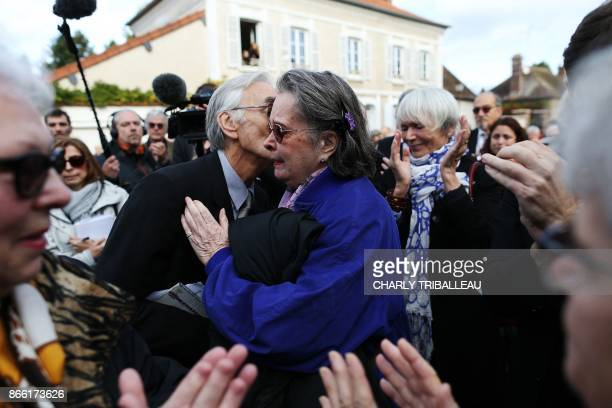 French actress Dominique Lavanant embraces Jacques Jenvrin the companion of the late French actress Danielle Darrieux as they attend her funeral...