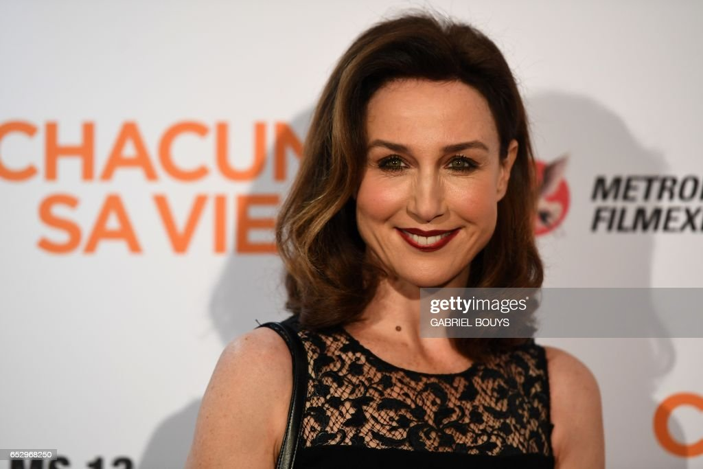 French actress Elsa Zylberstein poses during the photocall for the premiere of the film 'Chacun Sa Vie' in Paris on March 13, 2017. The film is directed by French director Claude Lelouch. /