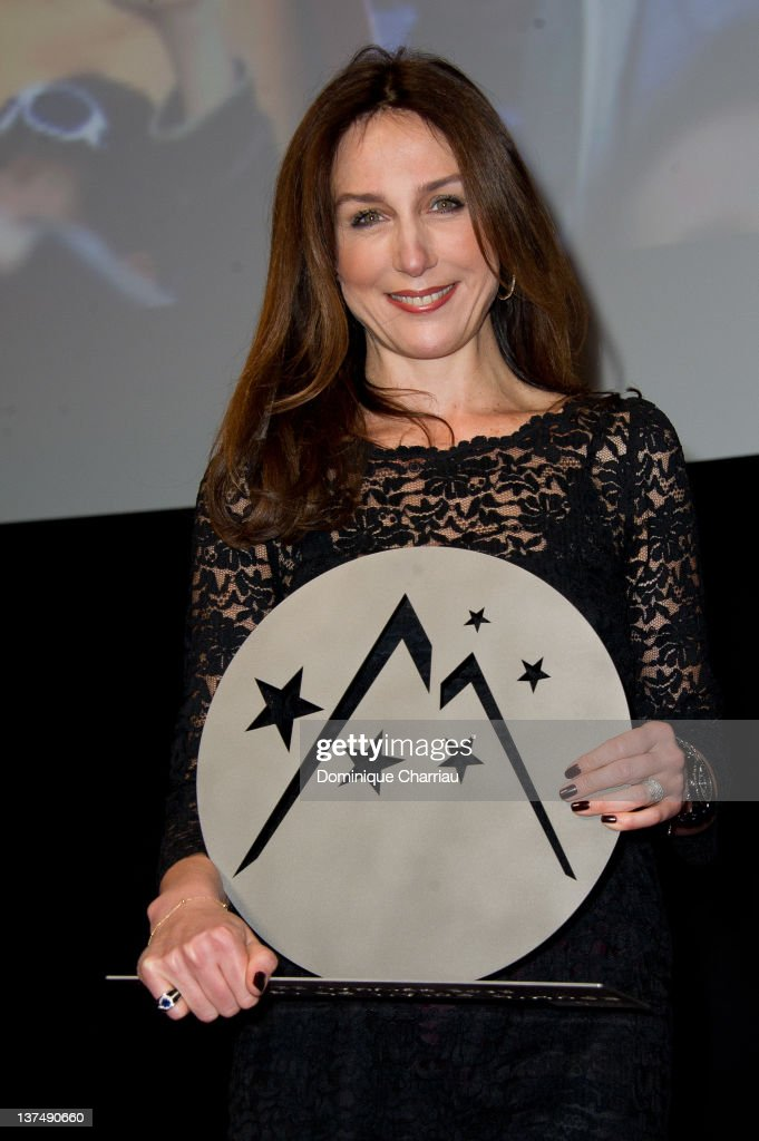 French actress Elsa Zylberstein receives the Award for Best Actress during the Closing Ceremony of the 15th L'Alpe D'Huez International Comedy Film...