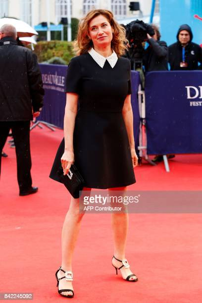 French actress Emmanuelle Devos arrives for the screening of the film 'Kidnap' during the 43rd Deauville US Film Festival in the northwestern sea...