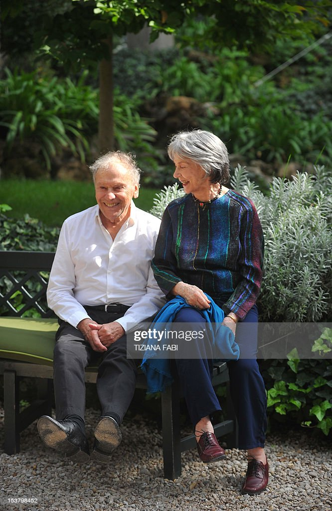 French actress Emmanuelle Riva (R) and French actor jean-Louis Trintignant pose during a photocall for 'Amour' on October 9, 2012 in Rome. 'Amour' a film by Austrian film director Michael Haneke with French actress Emmanuelle Riva and actor Jean-Louis Trintignant won the Palme d'Or at the 2012 Cannes film festival. AFP PHOTO / TIZIANA FABI