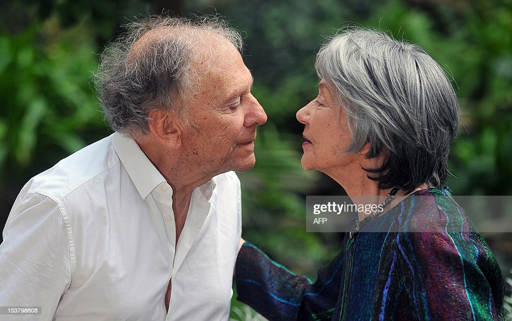 French actress Emmanuelle Riva (R) and French actor Jean-Louis Trintignant exchange a kiss during a photocall for 'Amour' on October 9, 2012 in Rome. 'Amour' a film by Austrian film director Michael Haneke with French actress Emmanuelle Riva and actor Jean-Louis Trintignant won the Palme d'Or at the 2012 Cannes film festival.